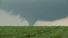 Distant, large violent tornado over farmland in Texas. High quality. Tripod. - stock footage