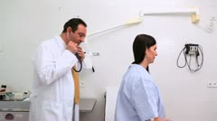 Patient being auscultated by a doctor Stock Footage