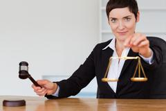 Judge with a gavel and the justice scale - stock photo