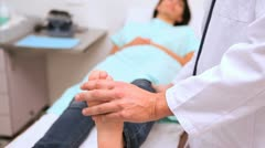 Doctor manipulating  foot of a patient - stock footage