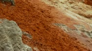 Red and white rock deposits in river canyon, fairy springs vietnam Stock Footage