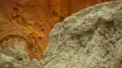 Pan across vividly coloured rock and sand deposits, canyon, bad lands, vietnam Stock Footage