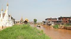 Boats at the Ywama pagoda Stock Footage