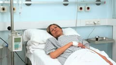 Female patient asleep on a medical bed Stock Footage