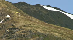 Paragliders Soaring at Hatcher Pass in Alaska rev zoom Stock Footage