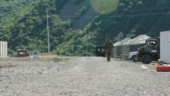 Soldier Walking on Base Oversees (HD)m Stock Footage