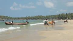 Fishing village sand beach Stock Footage