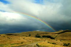Rainbow in the mountains - stock photo