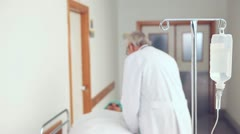Patient with  intravenous drip bag Stock Footage