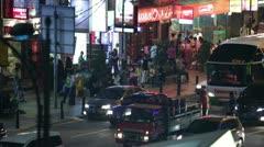 People walk down the street at night in Kuala Lumpur 2 Stock Footage