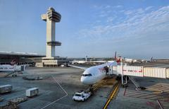 JFK Airport control tower aircraft sunrise New York City - stock photo