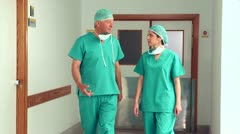 Nurse and a doctor walking in a hallway Stock Footage
