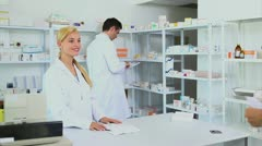 Someone giving a prescription to a pharmacist - stock footage