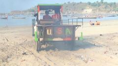 Tractor on sand beach Stock Footage