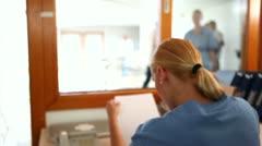 Nurse giving a folder to a nurse Stock Footage