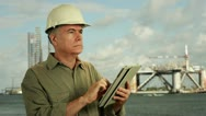 Stock Video Footage of Oilfield worker using a tablet pc