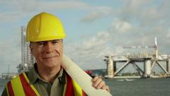 Oil platform worker smiles at camera Stock Footage