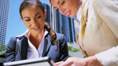 Business colleagues using wireless  internet - stock footage