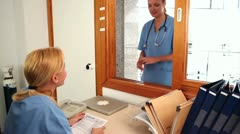 Nurse holding a file - stock footage