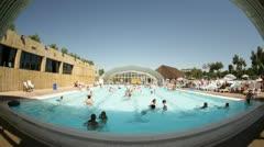 People enjoying public swimming pool Stock Footage