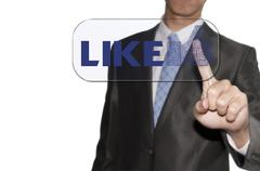 business man touching the like button - stock illustration