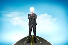 a business man bulb standing over road and blue sky the background - stock illustration