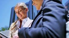 Female businesswomen using wireless tablet Stock Footage