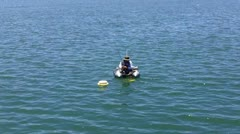 Man Fishing In Alamitos Bay From Small Inflatable Raft - stock footage