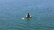 Man Fishing In Alamitos Bay From Small Inflatable Raft Stock Footage