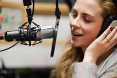 Close up of a singer recording a track Stock Photos