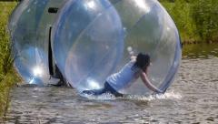 Girls having Zorbing fun - stock footage