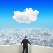 Black businessman on balcony looking at clouds Stock Illustration