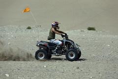 ATV rider side desert Little Sahara sand Dunes 2473.jpg - stock photo