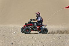 ATV ride side flag desert Little Sahara sand dunes 2470.jpg - stock photo