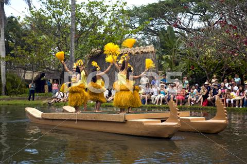 Stock photo of Hawaii Tahiti dancers canoe Hawaii