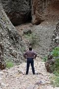 Man in slot canyon river basin in mountain 3592.jpg Stock Photos