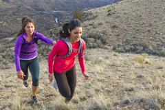 Hispanic runners training in remote area Stock Photos