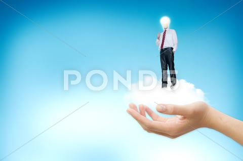 Stock Illustration of young businessman with blub stand up on the clouds.