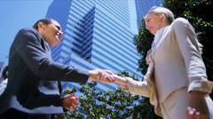 Young females shaking hands Stock Footage