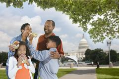 African American family eating hot dogs on vacation Stock Photos