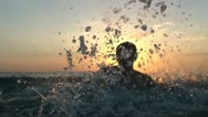Stock Video Footage of Man have water fun at sunset