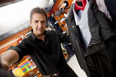 Hispanic man shopping for clothes in store Stock Photos