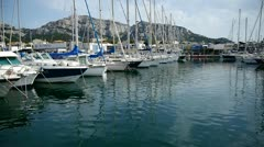 Yachts in harbor Stock Footage