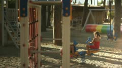 Children playing in playground - stock footage