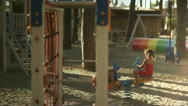 Children playing in playground Stock Footage