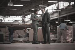 Black business people working in warehouse - stock photo