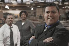 Business people standing in warehouse - stock photo