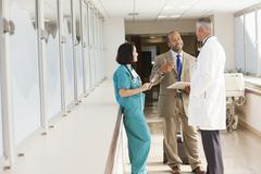 Doctors and drug salesman talking in hospital Stock Photos