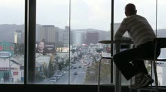 Man Looks out at City Stock Footage