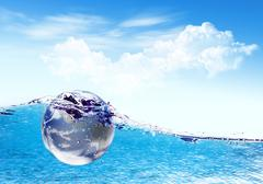 Earth falls deeply under water with a splash.elements of this image furnished Stock Illustration